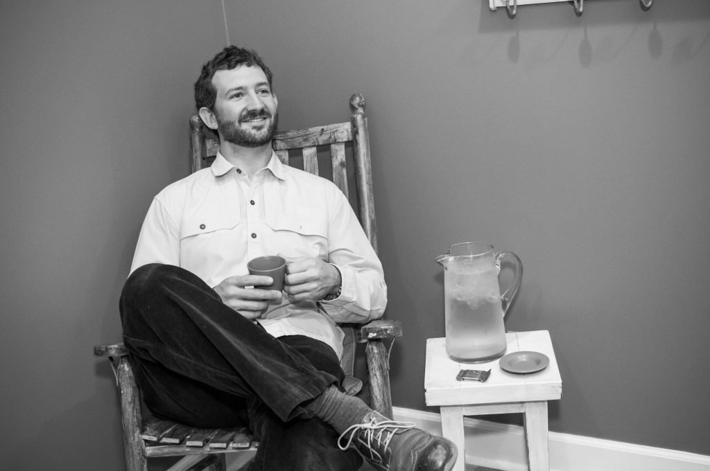 gentleman relaxing with tea and water
